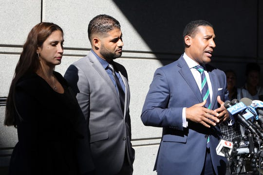 Marissa and Juan Rodriguez look on as attorney Joey Jackson speaks to the press after Juan Rodriguez, the New City father whose 1-year-old twins died in his hot car, returned to Bronx Criminal Court Oct. 24, 2019. His case was adjourned to Dec. 5.