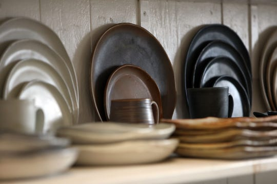 Plates and mugs by potter Connor McGinn at Makers Central in Tarrytown Oct. 16, 2019. Makers Central is a space for makers to work in a collaborative environment to produce high quality functional goods geared towards the restaurant industry.