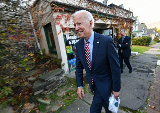 Former U.S. Vice President Joe Biden leaves Hank's Hogies with some treats after speaking at the Scranton Cultural Center in Scranton Pa., on Wednesday, Oct. 23, 2019.