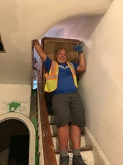 John Gutierrez, a GoShare driver from Freehold, New Jersey, helps move in furniture as part of a delivery for GoShare. The platform will soon launch in Delaware.
