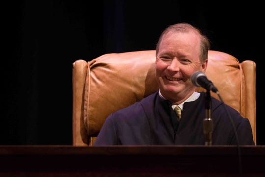 Collins J. Seitz, Jr. laughs with the crowd as Chief Justice Leo E. Strine, Jr. gives a response for the court on Friday, May 1, 2015.