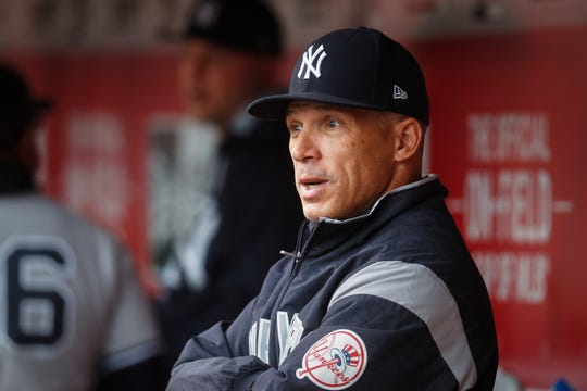In this May 9, 2017 file photo, then-New York Yankees manager Joe Girardi watches from the dugout before the first inning of a game in Cincinnati.