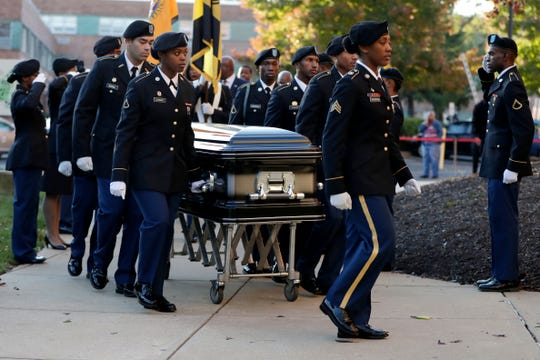 Pallbearers walk with a casket carrying the body of U.S. Rep. Elijah Cummings as it arrives at Morgan State University ahead of a public viewing, Wednesday, Oct. 23, 2019, in Baltimore.