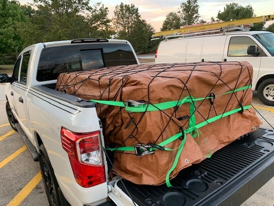 John Gutierrez strapped this package into the bed of his Nissan Titan to make a delivery for GoShare.