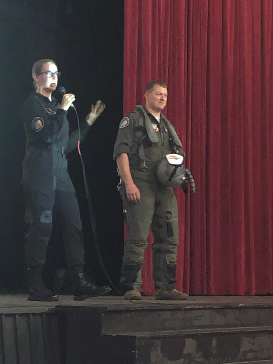 Staff Sgt. Annmarie Prozzillo, F-22 demo team aircrew flight equipment chief, left, and Capt. Duston O'Brien, pilot with the F-22 Raptor demo team, explain how equipment can help a pilot maintain consciousness while under strong gravitational forces. The team gave a presentation to Hirschi High School students Thursday afternoon. The team will be performing at the Sheppard Air Force Base Guardians of Freedom Air Show and Open House this weekend Oct. 26-27.