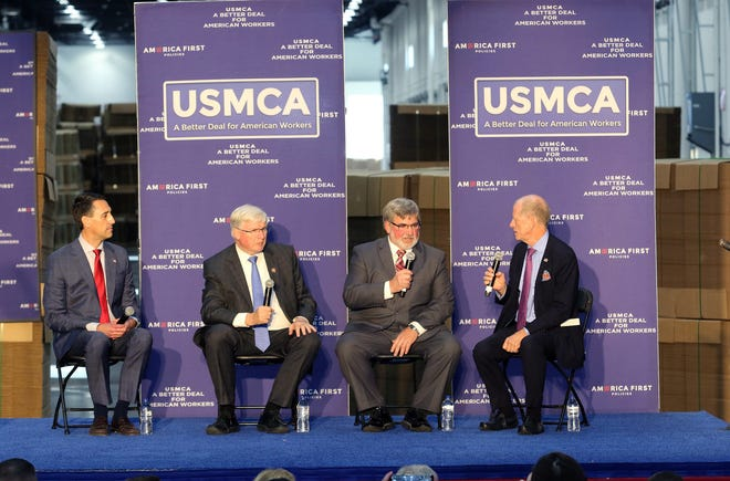 A panel discusses the USMCA trade deal during an America FIRST Policies event at Uline Warehouse in Pleasant Prairie on Oct. 23, 2019. Pictured, from left, are Zachary Mottl, chief alignment officer for Atlas Tools & Die Works, Rep. Glenn Grothman, Dave Daniels, Wisconsin Farm Bureau board member, and America First Policies Director Curtis Ellis.