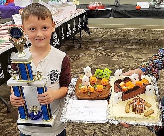 Jake Guilliams, 6, won the Rising Star Award in the kids category of the recent Coshocton Business and Professional Women 14th annual cake auction.