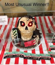 A skull cake by Kristine Otterstedy Mellor entered by Buckeye Beverage Barn won most unusual for the annual Coshocton BPW cake auction.