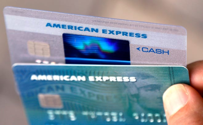 In this July 18, 2016, file photo, American Express credit cards are displayed in North Andover, Mass. Launched in 1969, the Green Card gave travelers a sense of importance they didn't feel carrying travelers' cheques. For many people, it was their first AmEx card. Over time, however, the Green Card became neglected in favor of its fancier siblings, the Gold and Platinum Cards.