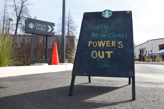 A sign at the entrance of the drive-thru at Starbucks warns customers the store is closed due to a power outage in Paradise, Calif., on Oct. 24, 2019. The Pacific Gas & Electric Co. cut power to 17 counties in Northern California to help prevent wildfires caused by downed power lines.