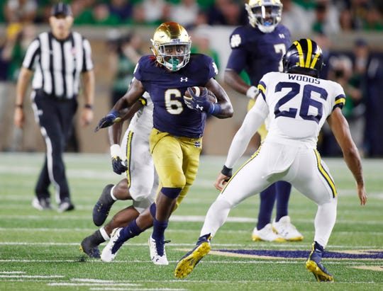 Notre Dame running back Tony Jones Jr. carries the ball against Michigan during the third quarter of their 2018 game at Notre Dame Stadium.