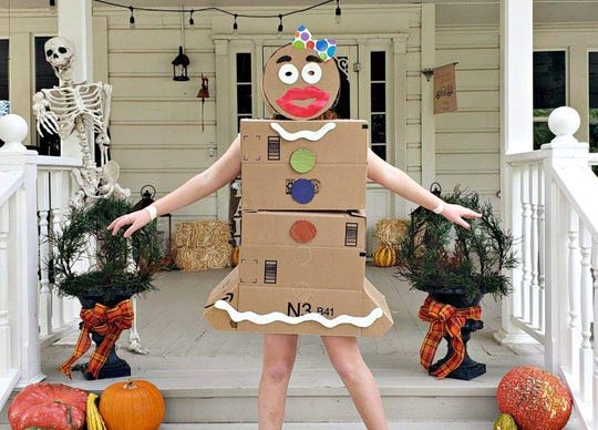 Make a gingerbread costume out of Amazon boxes.