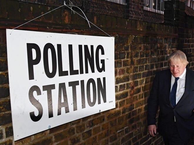 British Prime Minister Boris Johnson walks towards a voting station during the Brexit referendum in Britain, June 23, 2016.
