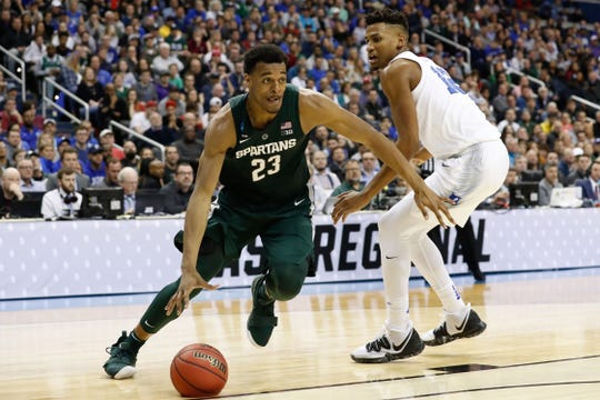 Michigan State forward Xavier Tillman drives to the basket past Duke forward Javin DeLaurier during the Elite Eight of the East Regional of the 2019 NCAA tournament at Capital One Arena.
