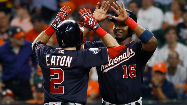 Washington Nationals' Adam Eaton celebrates his two-run home run with Victor Robles in the eighth inning.