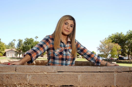 In this Tuesday, Oct. 15, 2019 photo, college student, Sheida Assar, poses for a photo, in Chandler, Ariz. Colleges are becoming a battleground in the conflict between federal and state marijuana laws. Assar said she was expelled from GateWay Community College in Phoenix last month for violating the school's drug policy after she tested positive for marijuana, which she uses to treat chronic pain from polycystic ovary syndrome.