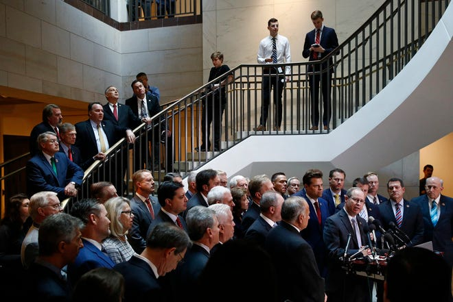 House Republicans gather for a news conference Oct. 23 after Deputy Assistant Secretary of Defense Laura Cooper arrived for a closed door meeting to testify as part of the House impeachment inquiry into President Donald Trump on Capitol Hill in Washington.