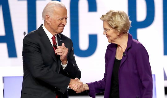 Former Vice President Joe Biden and Sen. Elizabeth Warren, D-Mass., greet each other during the Democratic Presidential Debate at Otterbein University on Oct. 15, 2019, in Westerville, Ohio.