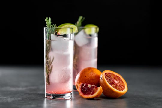 Skullcap herbal mocktail with rosemary and blood orange.