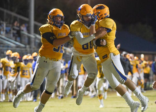 Wren senior Dylan Langley(80),middle, is congratulated after scoring a touchdown during the fourth quarter at Wren High School in Piedmont Thursday, October 24, 2019. Wren won 55-28.