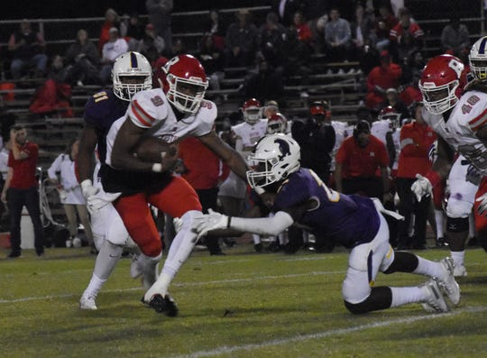 Ruston running back Ketravion Hargrove (9) breaks free from the Alexandria Senior High defense for a touchdown during the Trojans' 17-13 win.