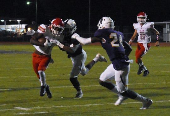 Ruston receiver Marcus Harris (1) tries to break tackles from Alexandria Senior High defenders Thursday.