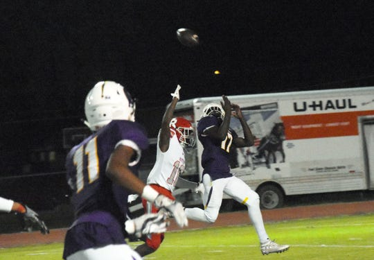 Alexandria Senior High receiver Derrald Moore (17) catches a pass against Ruston Thursday. Moore caught eight passes for 156 yards and the game-winning touchdown as the Trojans won with a score of 17-13.