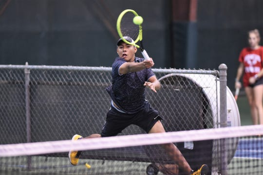 Abilene High's Rolando Rivera hits a shot on the run during the No. 6 singles match against Flower Mound Marcus.
