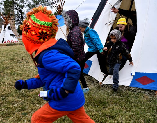 Children run from one tipi to another Friday at McMurry University.