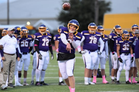 Wylie quarterback Balin Valentine (2) throws a pass during pregame warmups before the game against Canyon Randall at Bulldog Stadium on Friday, Oct. 25, 2019.