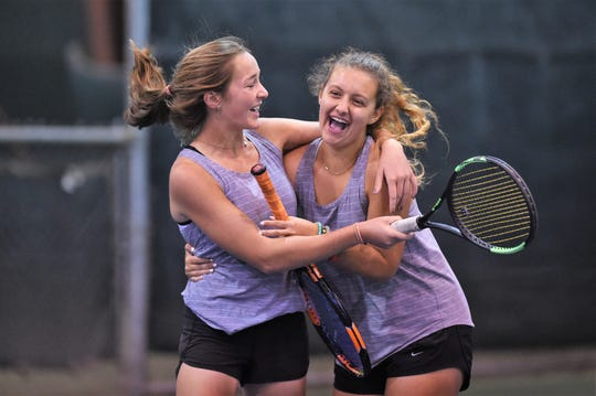 Abilene High's Charlie Anderson, left, and Tia Pupella celebrate winning a three-set match at No. 3 girls doubles against Flower Mound Marcus in the Region I-6A semifinals.