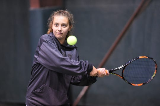 Abilene High's Tia Pupella lines up a shot during the No. 5 singles match against Flower Mound Marcus in the Region I-6A semifinals at the Fairway Oaks indoor courts Thursday. Pupella forced a third set before falling as the Eagles battled before falling 10-9 to end their season.