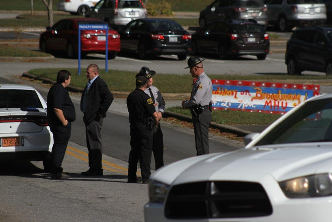 Law enforcement officers and first responders block access to Madison Middle School after a bomb threat forced evacuation of the school Oct. 15.