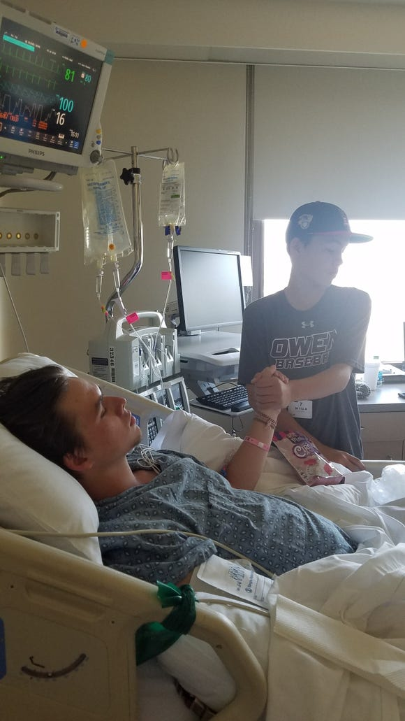 Devin Gildner and his brother Liam in the hospital