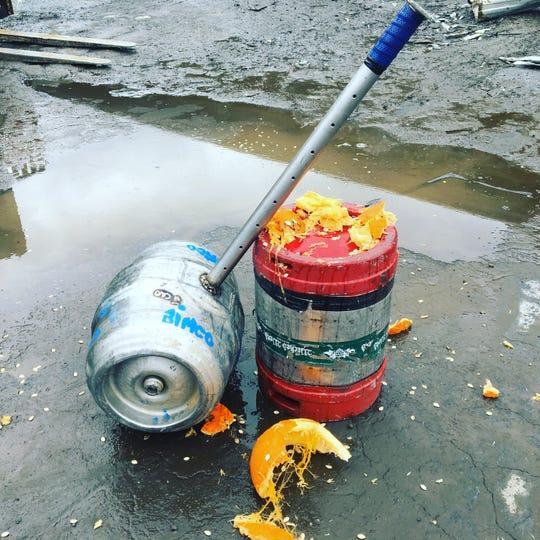 A giant keg hammer makes short work of pumpkins at Smash Don't Trash in 2018.