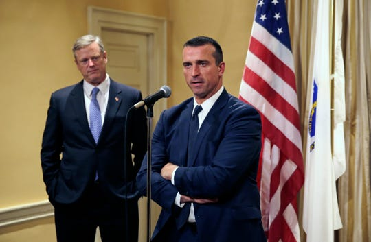 Former NBA player Chris Herren, right, addresses reporters as he stands with Massachusetts Gov. Charlie Baker at the Statehouse in Boston in 2015. Herren shares his story on overcoming addiction as a lecturer.