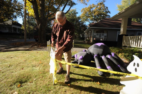 Jack Taylor, one of several residents on Church Street who decorates his home for Halloween, gave away 1,800 pieces of candy last year before running out.