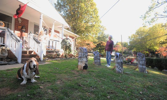 Guydana Taylor and her dog Wendell prepare to welcome hundreds of trick-or-treaters to their Black Mountain home on Halloween.