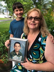 Joan Majid, with her son Daniel, holds a picture of her son Adam, who died in 2005 and would have turned 25 this year.