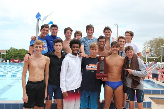 Titusville's boys won the District 9-2A swimming & diving meet on Friday at Cocoa Beach Aquatic Center.