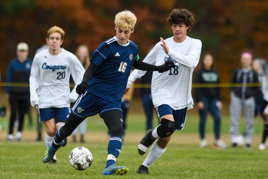 Essex's Stefan Digangi (16) plays the ball last MMU's Easton FitzHugh (18) during the boys soccer quarterfinal game between the Mount Mansfield Cougars and the Essex Hornets at Essex High School on Friday afternoon October 25, 2019 in Essex, Vermont.