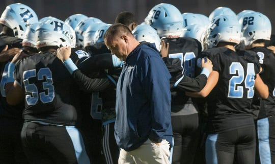 Highland football coach Brian Leary and players take to the field prior to the game between Highland and Burlington Township played at Highland Regional High School in Blackwood on Friday, October 25, 2019.