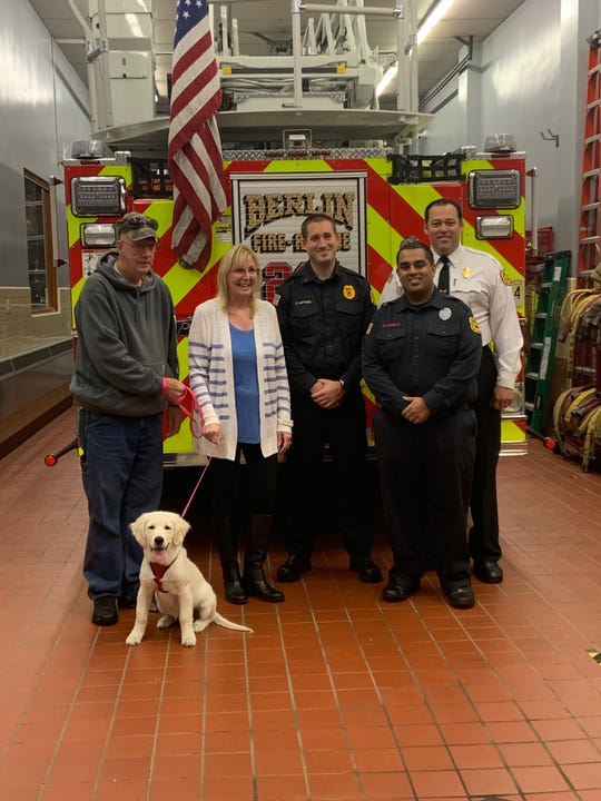 Ava, an English Cream Golden Retriever puppy, sports a shirt showing support for Berlin Fire Company No. 1. Three members of the volunteer fire company saved Ava's life when she became entangled in her crate on Oct. 19.