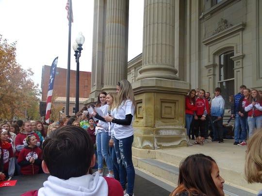 Megan Schiltz, Nicole Garrett, and Leila Arowood from Huntington High School address the crowd at Friday's MADE rally.