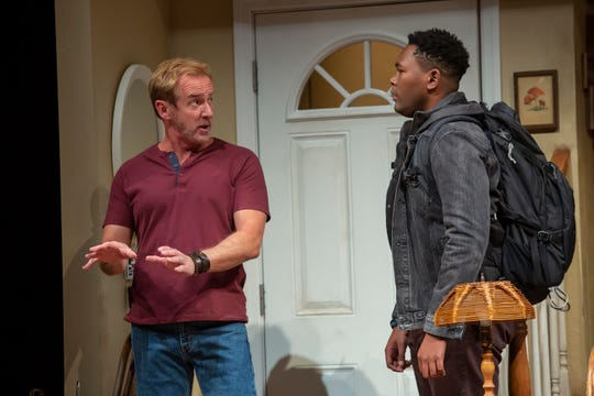 "David Whalen, left, plays a gifted essayist whose accuracy is being challenged by a young fact-checker, played by JuCoby Johnson, right, in the Playhouse in the Park production of ""The Lifespan of a Fact."" The show runs through Nov. 16."