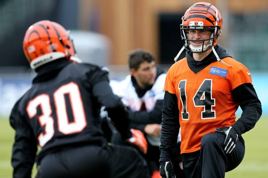 Cincinnati Bengals quarterback Andy Dalton (14) talks with Cincinnati Bengals free safety Jessie Bates (30) during practice ahead of the team's NFL International Series game against the Los Angeles Rams, Friday, Oct. 25, 2019, at Allianz Park in London, England.