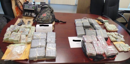 Cocaine, money and firearms were seized as part of a drug bust in Hamilton County this week.