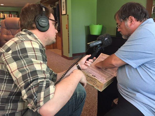 Drake Jr. recording Dayton historian Curt Dalton as he looks through a city directory.