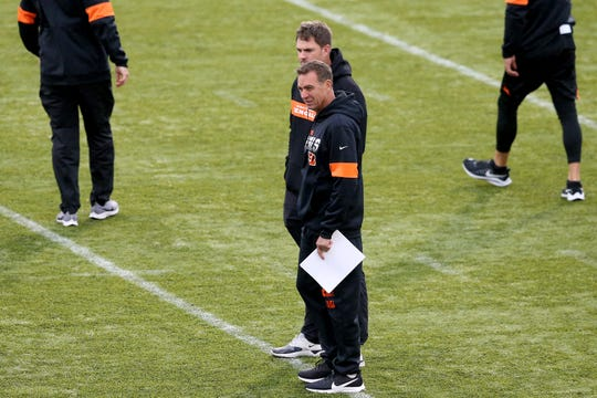 Cincinnati Bengals head coach Zac Taylor and defensive coordinator Lou Anarumo talk talk as the team practices ahead of the NFL International Series game against the Los Angeles Rams, Friday, Oct. 25, 2019, at Allianz Park in London, England.