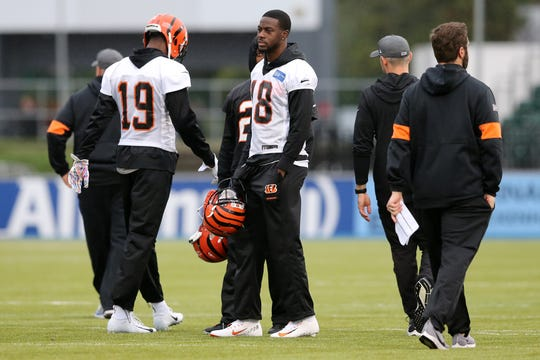 Cincinnati Bengals wide receiver A.J. Green (18), center, who is not expected to play against the Los Angeles Rams, observes during practice, Friday, Oct. 25, 2019, at Allianz Park in London, England.